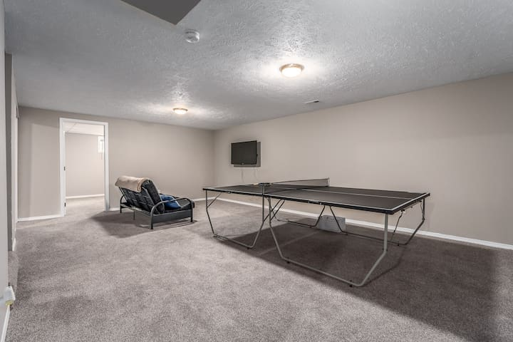 Basement Family Room with ping pong and second television and futon.