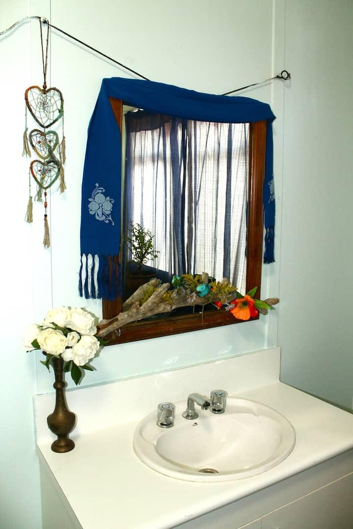 Quirky, invitingly comfy, spacious & artsy room.