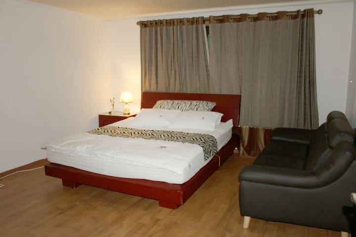 Room 1 is wide enough to accommodate a king-sized bed.
