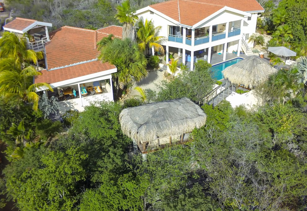 Aerial view from the property. Left the bungalow with carport, front and back porche, roof terrace, 2 gazebo's in garden and next to the pool, a tropical garden and salt water pool. Everything ONLY for PRIVATE use of the GUESTS.
