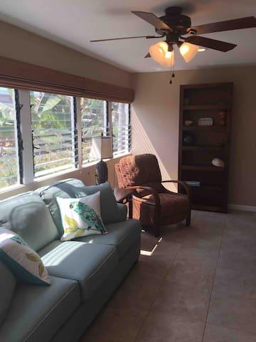 Queen sleeper sofa in family room with unobstructed ocean views.