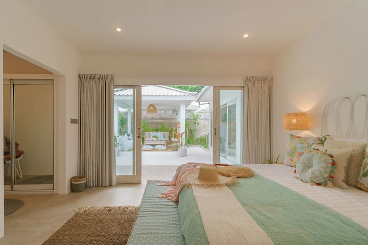 Secluded bedroom is spacious and inviting.