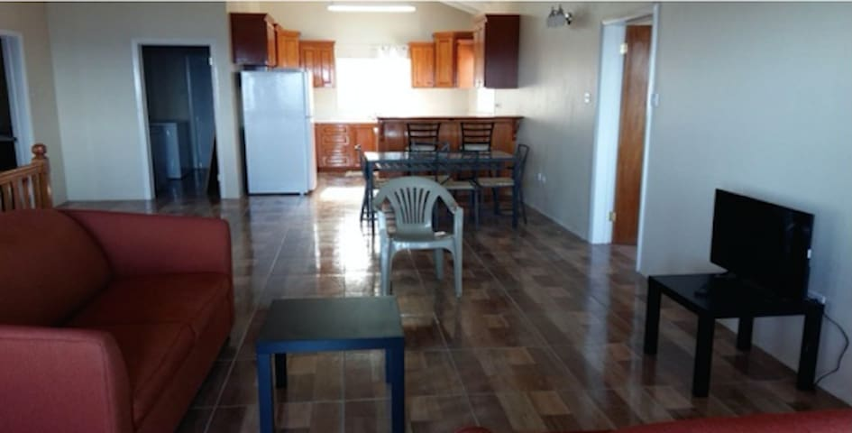 LIVING ROOM APARTMENT #201 (Two Bedroom, 2nd Floor)  LOCATION: 33 Stone Fort Heights Challengers Village, Trinity Parish St. Kitts  Rental Inquires: Short/Longterm sfhstkittshaven@gmail.com 33stonefortheights@gmail.com