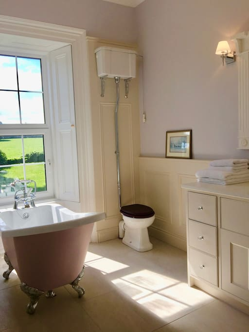 Lavender ensuite with slipper tub and separate shower.