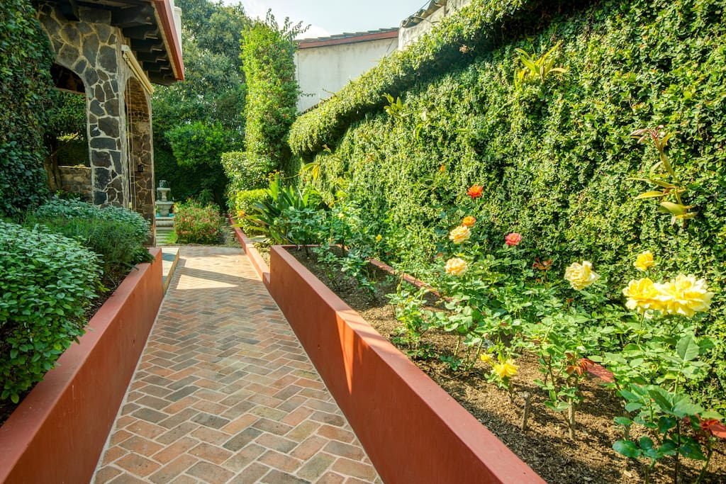 A spice garden & a rose garden greet you as you approach the house entrance.