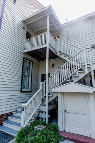 Exterior stairs to landing entrance