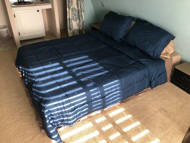 Loft bedroom with comfy memory foam topper