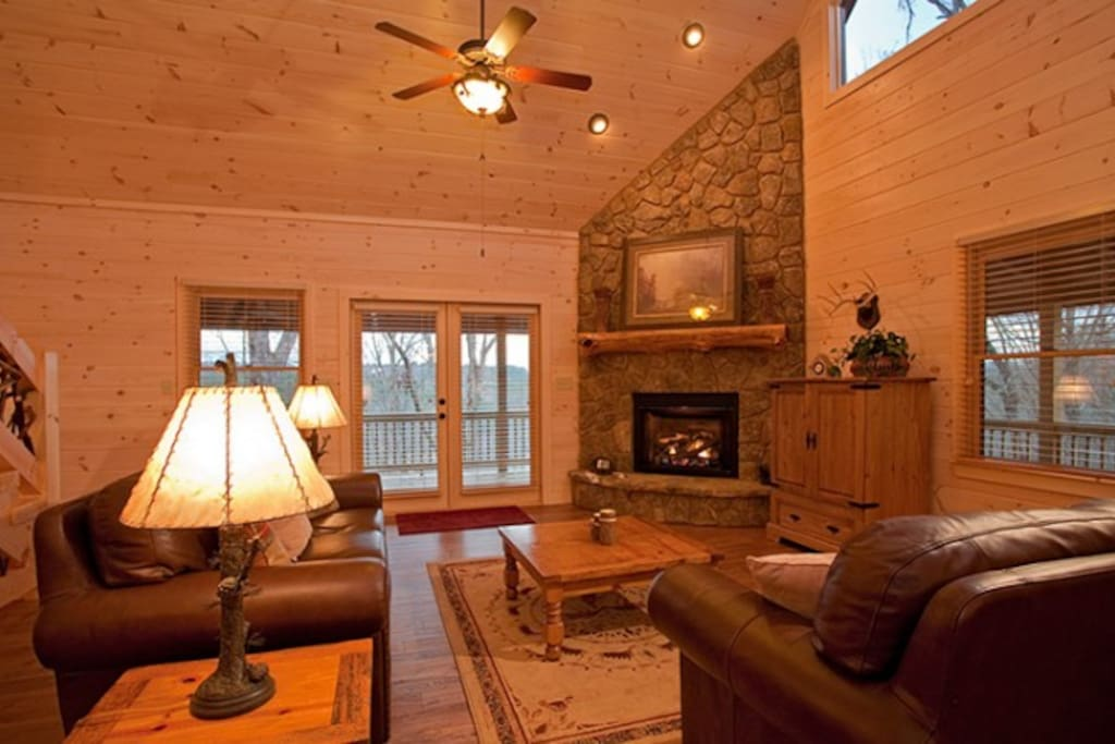 Stunning Stone Gas Log Fireplace, HDTV, and Lodge-Like Accessories