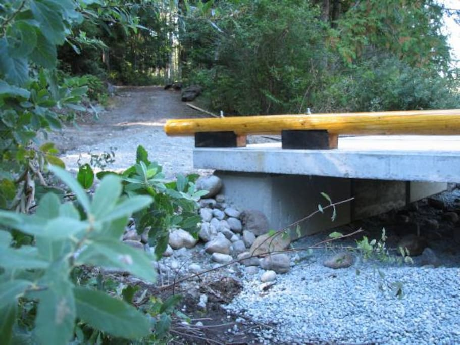 Bridge over Creek and road to house