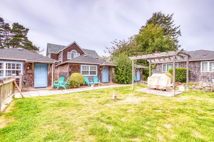 3 cozy, dog-friendly cottages w/gas fireplaces, shared courtyard, & beach access