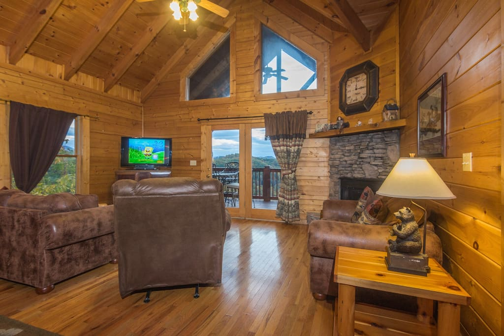 The main entrance leads to the living room on the upper level. The living room has access to the upper deck.