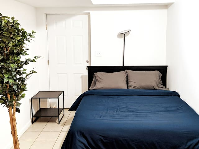 Bedroom #1 (separated by living room by room dividing curtains, that door is to the backyard)