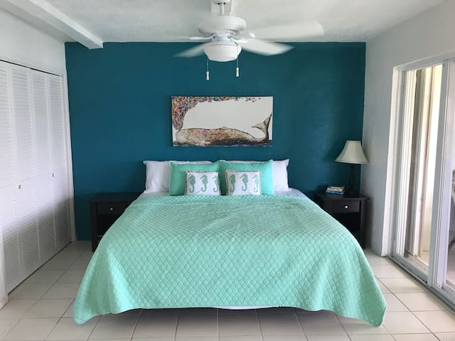 This is the second bedroom in the condo!  Each bedroom has its own full bathroom. This bedroom as a ocean front view and access to the back porch.