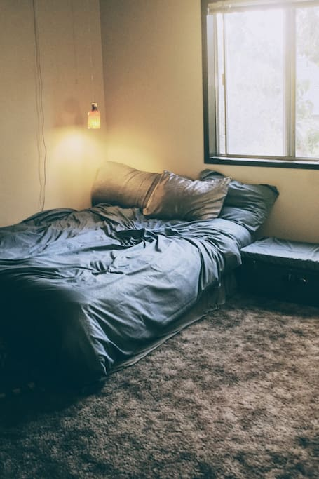 Cozy queen size bed with reading lamp