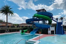 Water Slide in community swimming pool, steps away and free. Check with clubhouse for open hours schedule.