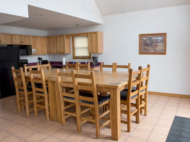 Huge table for family meals, meetings and games.