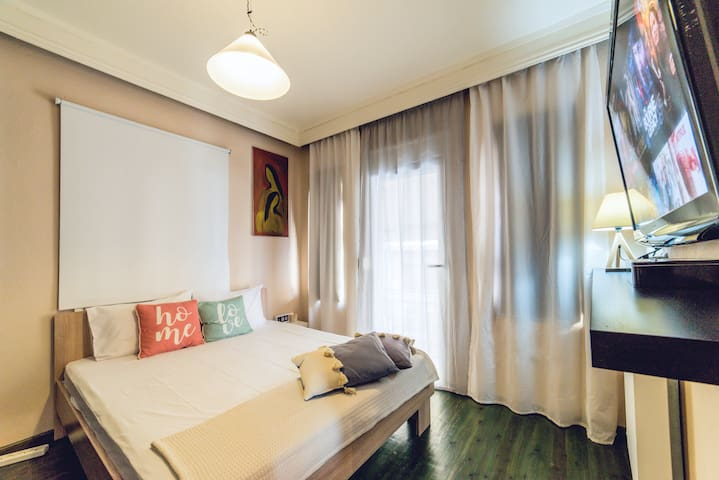 """The main bedroom with the King size double bed and the The 50"""" Smart TV"""