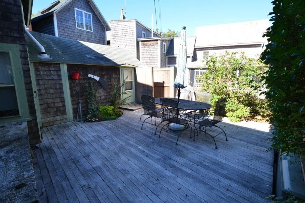 Side deck with outdoor shower, patio furniture and BBQ