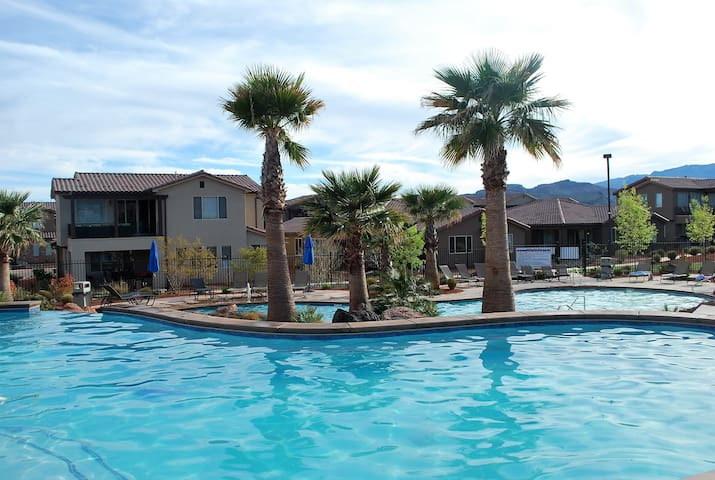 Relaxing 2 level pool plus 22 person hot tub and private hot tub in back yard