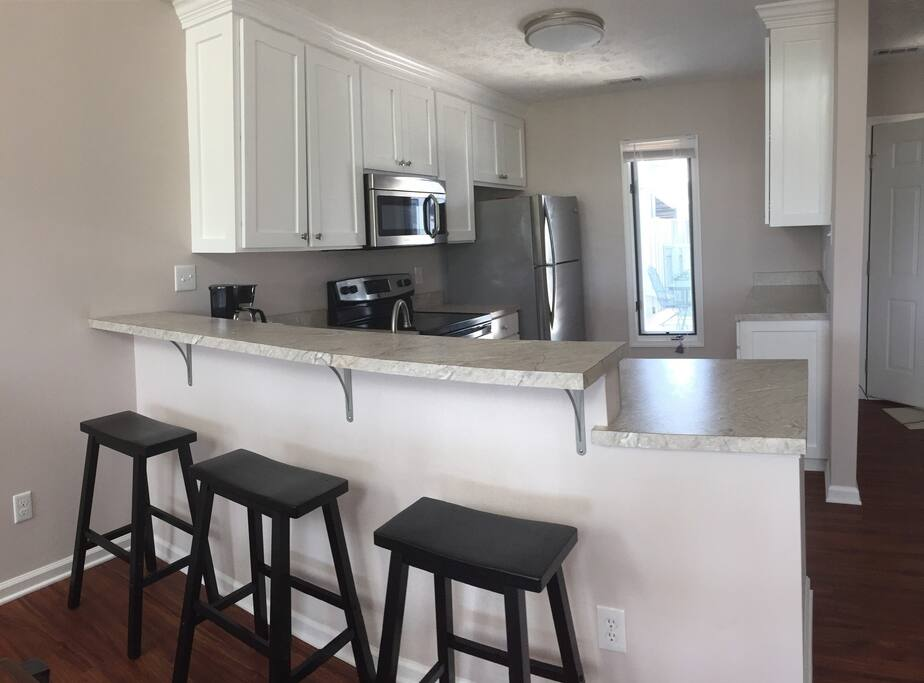 Remodeled, fully-equipped kitchen with high end appliances. Breakfast bar for 3.