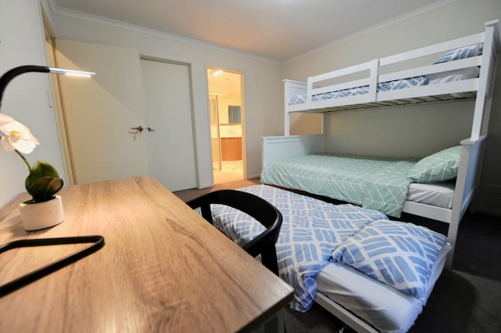 Room 2 with a single/double bunk bed, a single bed trundle and an attached ensuite