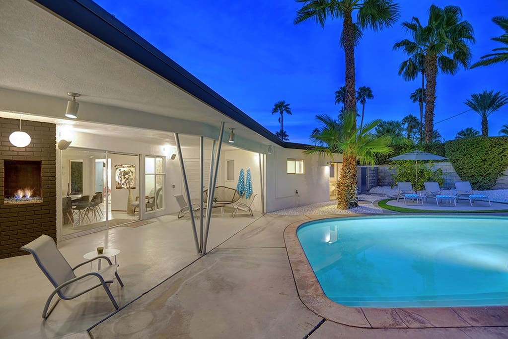 BACK OF HOUSE ANGLED AND POOL NIGHT - THE RETRO HOUSE - PALM SPRINGS VACATION RENTAL POOL HOME