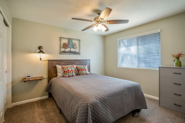 Your second bedroom features a queen-sized bed with the option of over-sized or regular-sized pillows, dresser, luggage rack, closet, and a digital alarm clock!