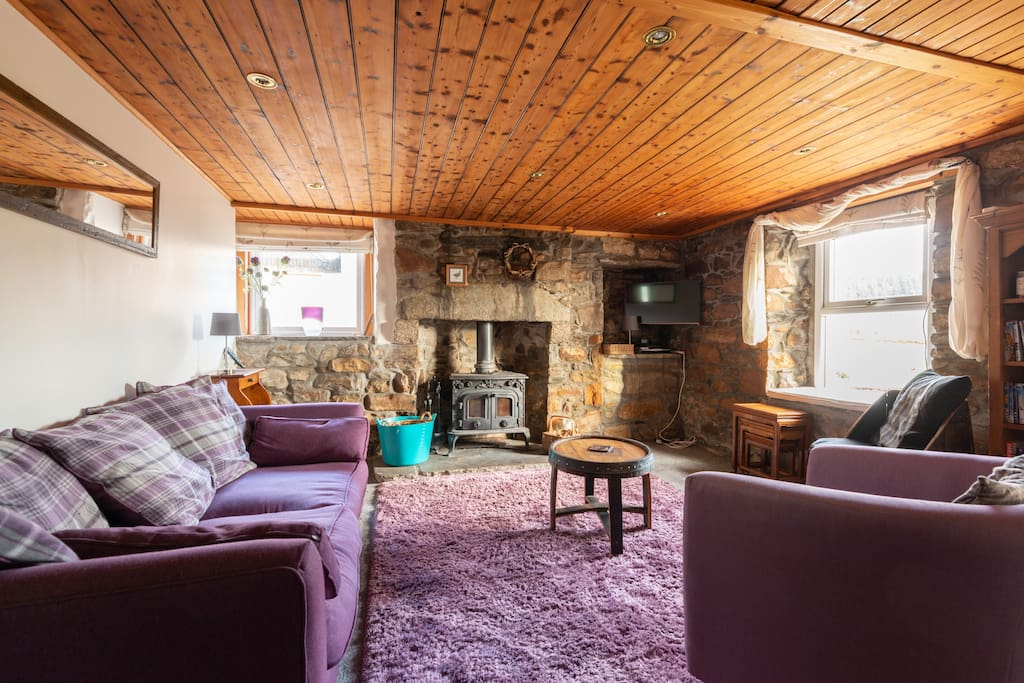Large cosy lounge with 2 sofas, more armchairs.  Double woodburning stove, sky tv, dvd player, apple tv.
