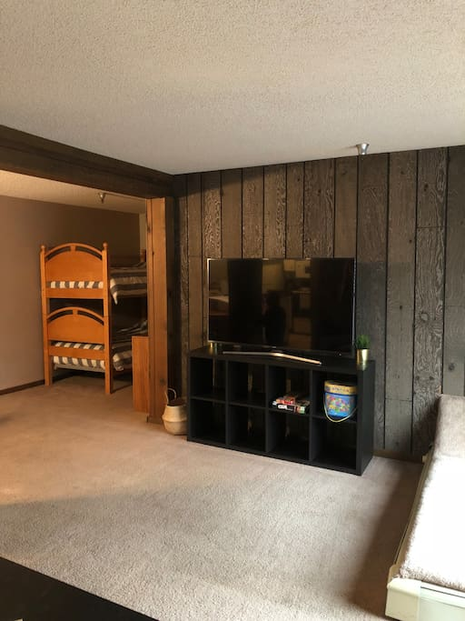 Large TV and entertainment center.