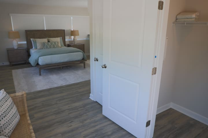 Large closet space adjacent to bedroom