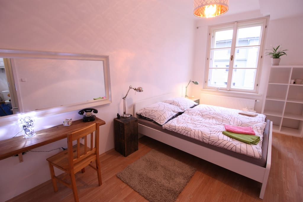 In bedroom is also cosmetic/working table with lamp.