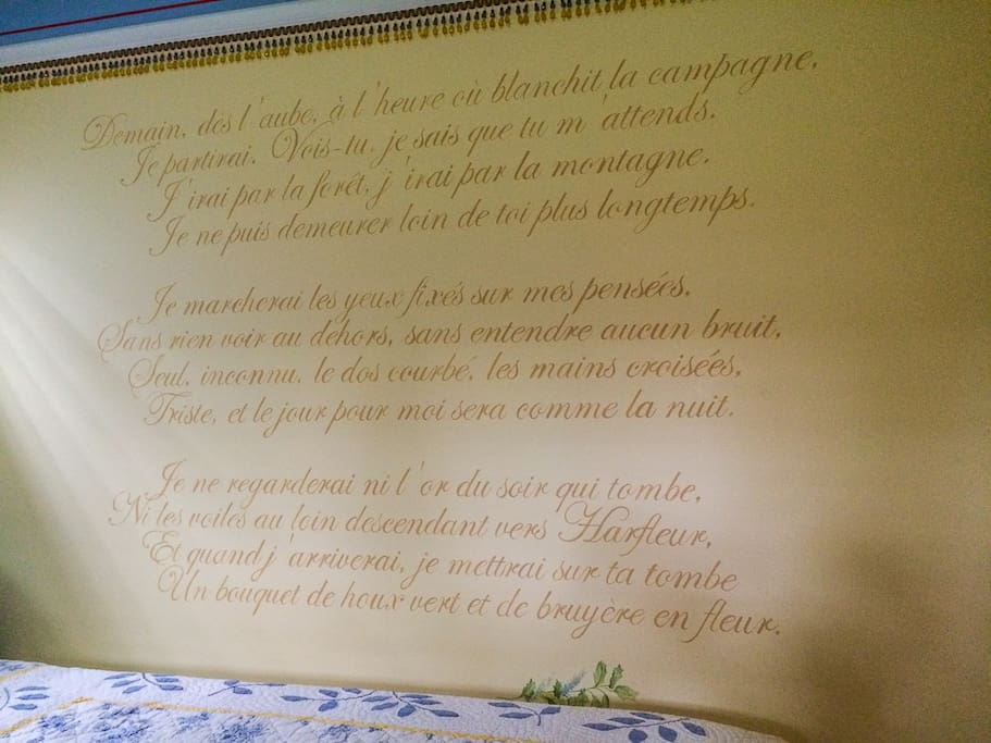 Hand-painted mural of a Victor Hugo poem in French. We'll give you an English translation!