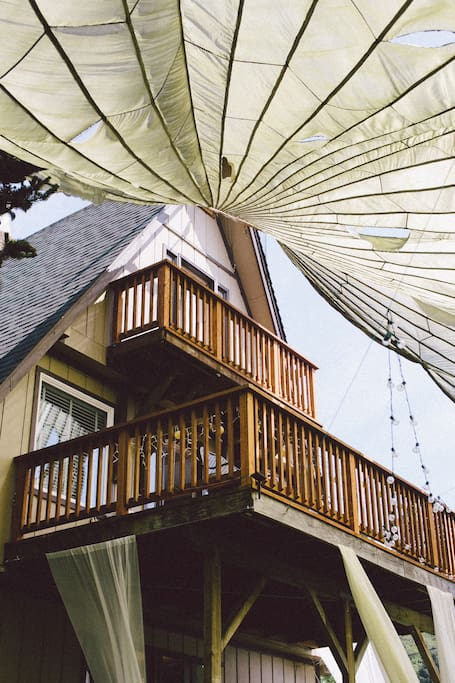 The outside of the house, with parachute from a wedding.
