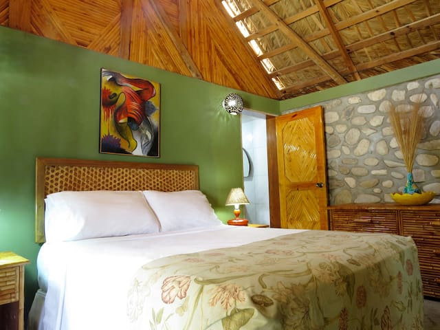 Rm 2: Comfortable bed, private bath, local bamboo furniture.