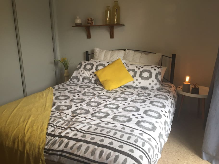 Queen size bed with towels and linens included.