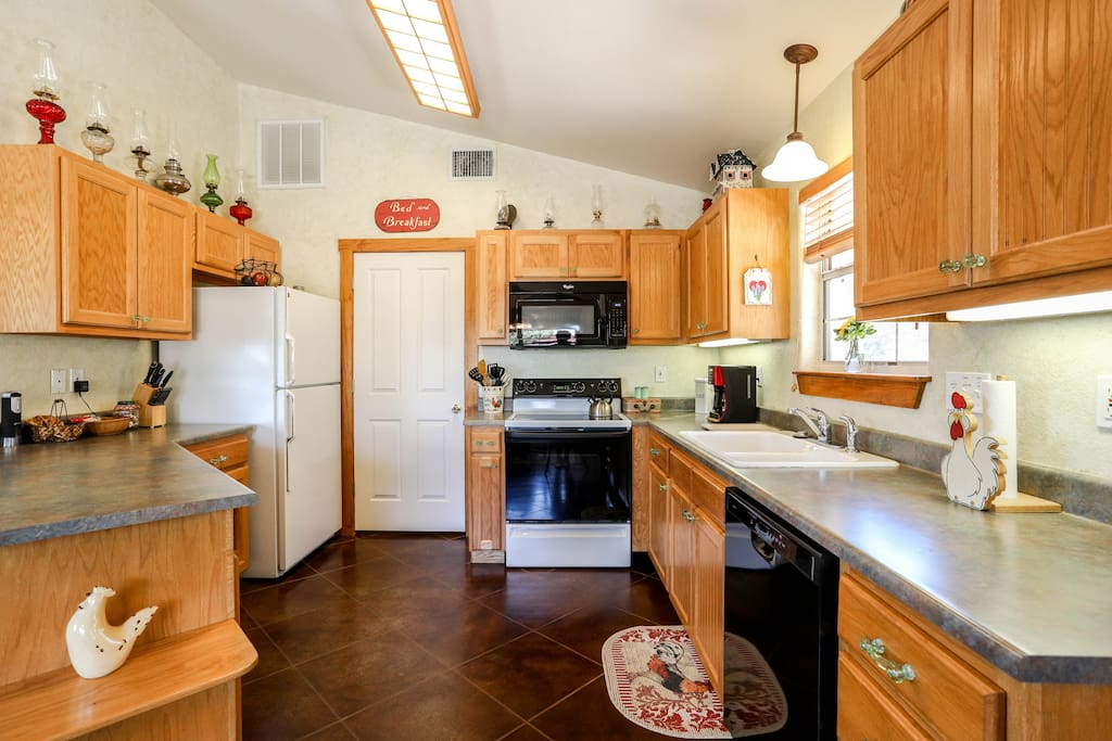 Full kitchen includes a range/oven, refrigerator, microwave, dishwasher, coffeemaker, and toaster