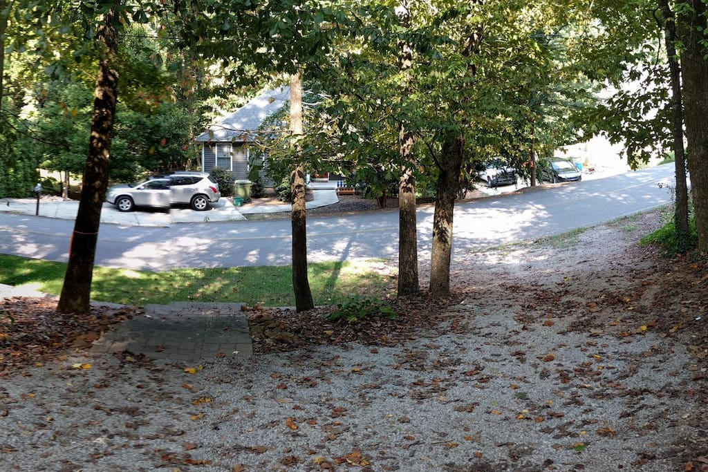 Front yard has a pull through driveway - your parking area. Fits 4 cars, easily. End to end.