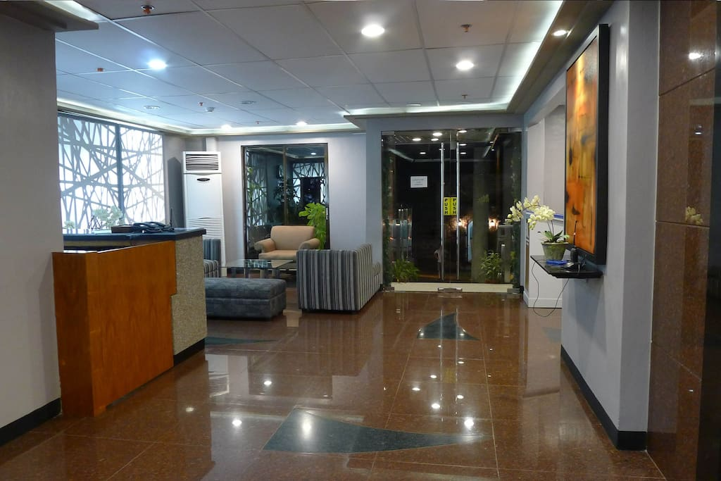 Lobby with marble floors and seating reception