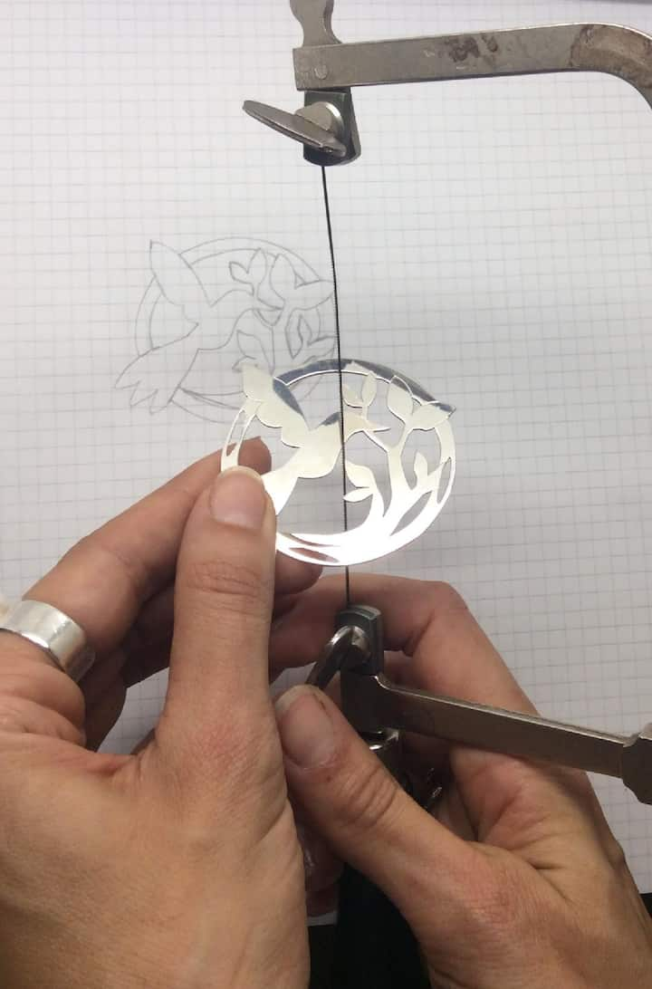 Cutting out the design with the saw