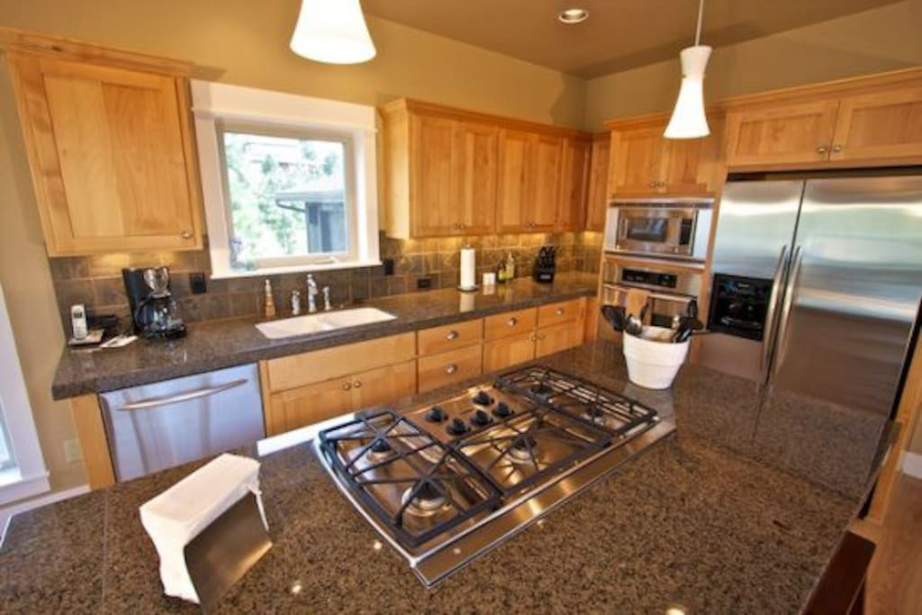 Fully Equipped Gourmet Kitchen with Gas Range, Granite Slab Counter Tops