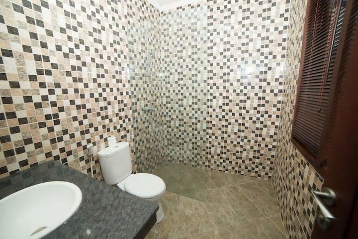 Private Room Shared Swimming Pool South Kuta R1
