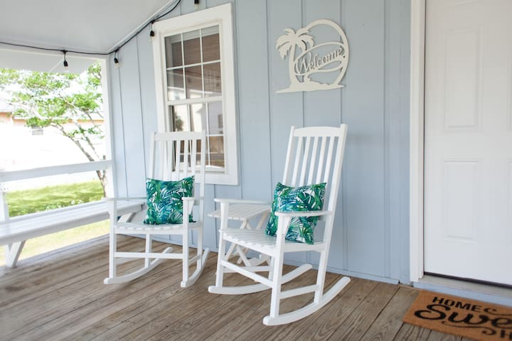 Listen to the waves and view the lake from the rocking chairs