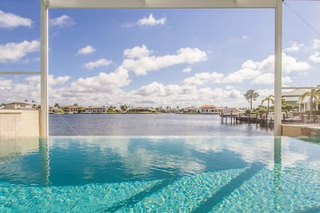 Elegant Home with Wide Water View & Walk to Beach!