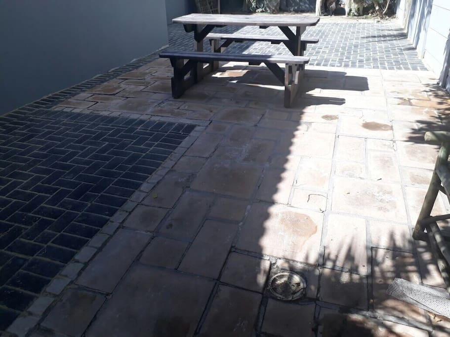 Private paved garden with BBQ