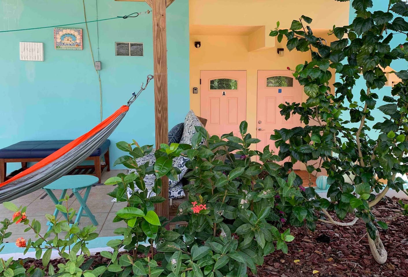 Suite A! We call it the Royal Palm! Gardens surround your private covered deck and patio with hammock and benches!
