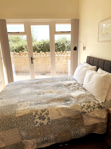 Guest bedroom with king-size bed with outside access