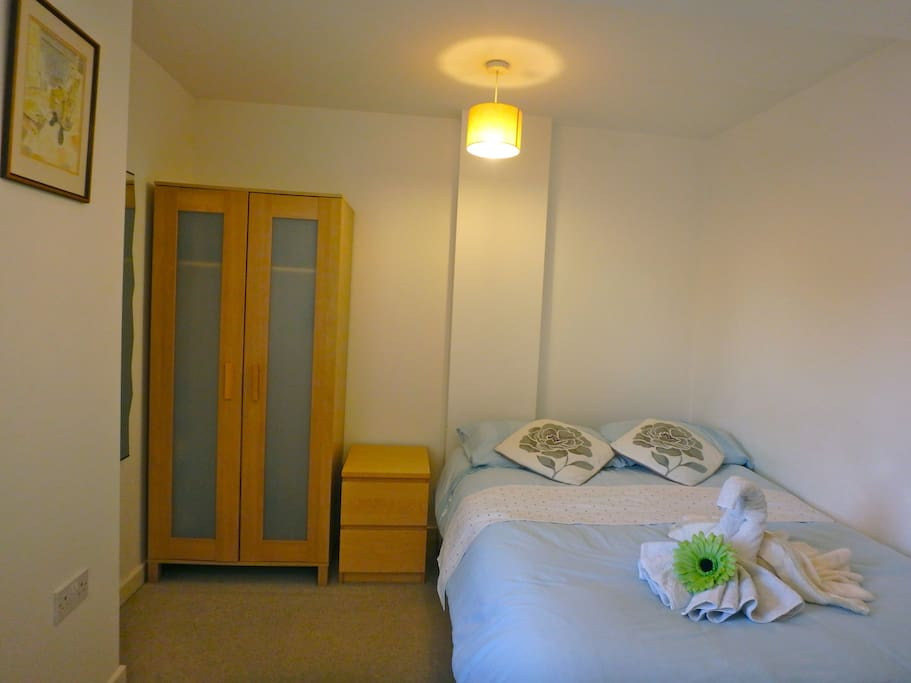 Double bedroom with wardrobe, x2 draws and storage under the bed