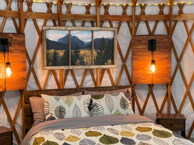Sleep snugly nestled in to this cozy queen bed with a view of the stars through the skylight above. The image of Two Medicine is by local artist Cari Bowers of Glacier Window Art.