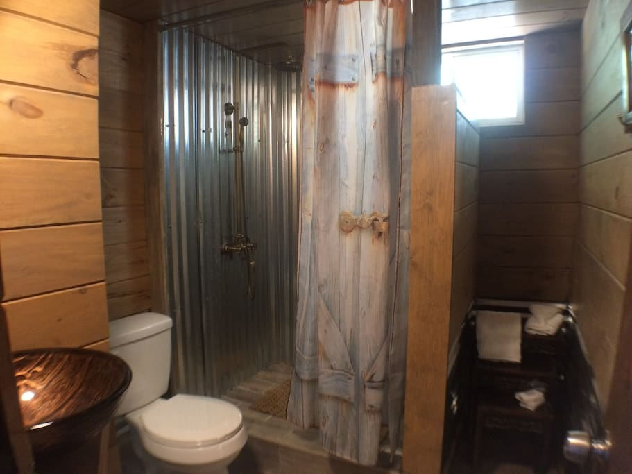 The large shower is part of the remodeled bathroom