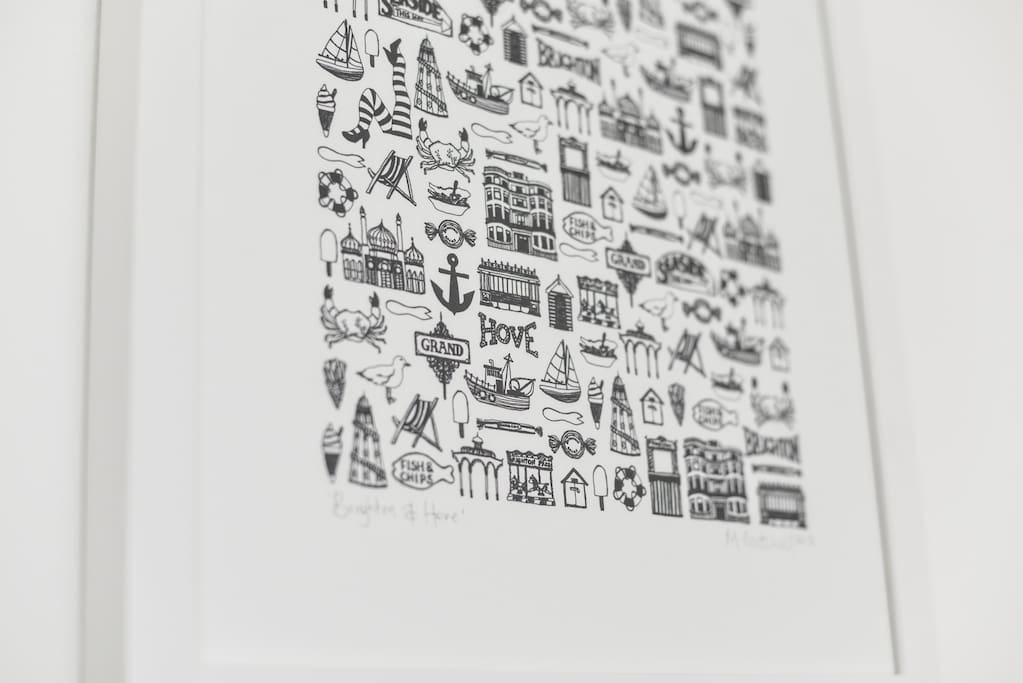 Brighton sightseeing 'icons' framed screen print in living room.